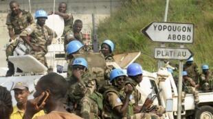 UN peacekeepers on patrol in Abidjan, January 2011