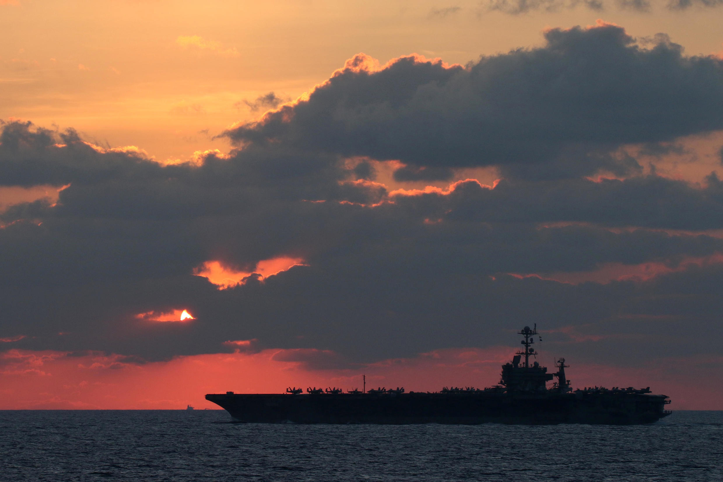 The U.S. Navy aircraft carrier USS John C. Stennis transits the South China Sea at sunset, February 25, 2019. But will US military might stand in the way if China decides to invade Taiwan?