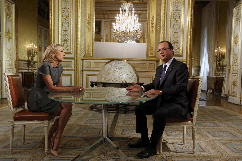 O presidente francês, François Hollande em entrevista à rede de TV francesa TF1, neste domingo, 15 de setembro de 2013.