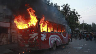 A bus in flames in Dhaka during the hartal
