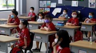 Les élèves d'une école de Ho Chi Minh, au Vietnam, le 11 mai 2020.