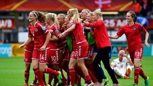 Denmark's players react after winning the quarter-final UEFA Women's Euro 2017 football match against Germany at Stadium Sparta