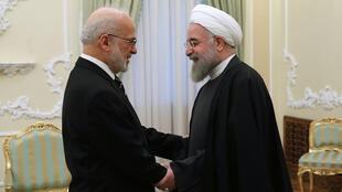 Iranian President Hassan Rouhani (R)  with Foreign Affairs Minister Ibrahim Jafari earlier this month