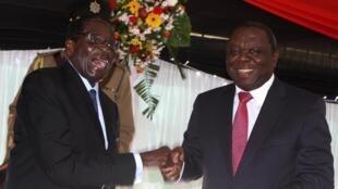 Presidente Robert Mugabe, e o Primeiro ministro Morgan Tsvangirai a 22 de maio de 2013
