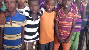 Abdiqadir students taking a break from playing in their classroom-cum-home in Awdal region, Somaliland