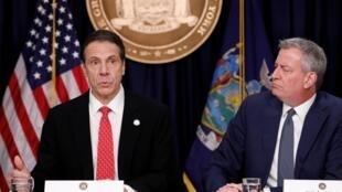Thống đốc bang New York Andrew Cuomo (T) và thị trưởng Bill de Blasio trong cuộc họp báo về virus corona, ngày 02/03/2020