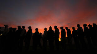 Voters queue in the early morning for South Africa's municipal elections