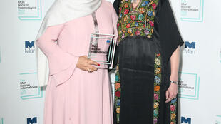 Omani author Jokha Alharthi and translator Marilyn Booth pose after winning the Man Booker International prize, London May 21, 2019.