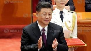 Chủ tịch Trung Quốc Tập Cận Bình (T) tại lễ kỷ niệm 40 năm cải tổ và mở cửa, Bắc Kinh, 18/12/2018.