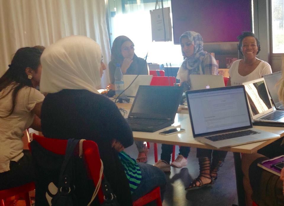 A group of refugee students take part in a coding class taught by Refugee on Rails, Berlin, August 2016