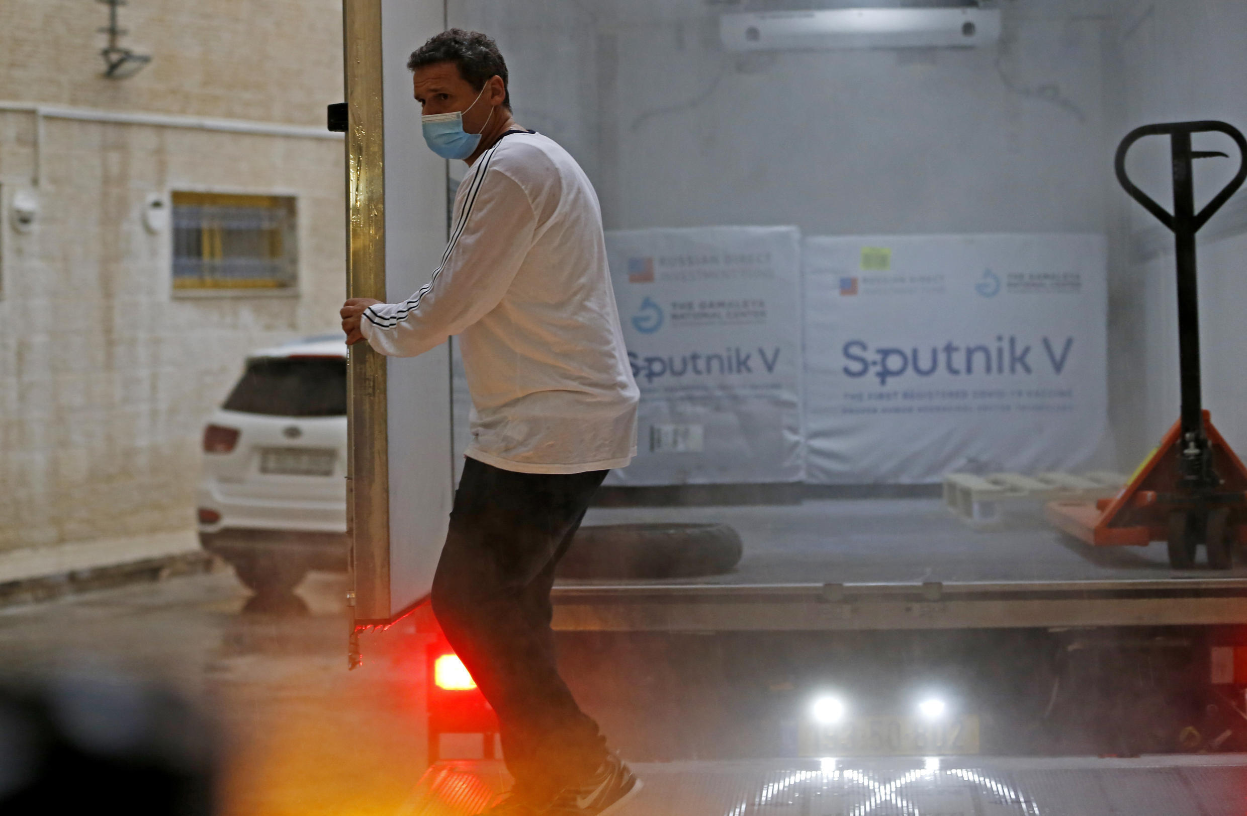 A truck carrying the first batch of Russia's Sputnik V COVID-19 vaccine arrives to the West Bank city of Ramallah on Thursday