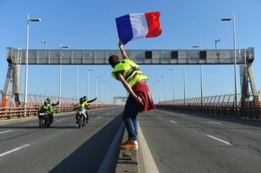 """The """"Yellow Vest"""" movement is named after the high-visibility vests motorists are required to carry in their cars. Many protesters stationed themselves at motorway toll booths."""