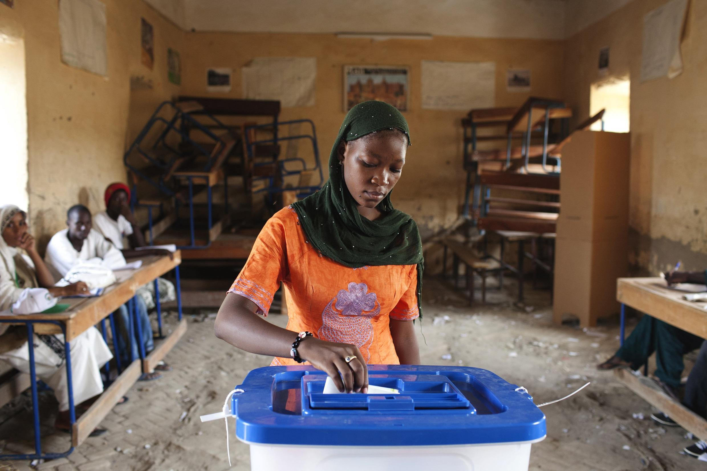 A woman votes in the first round of Mali's election on Sunday