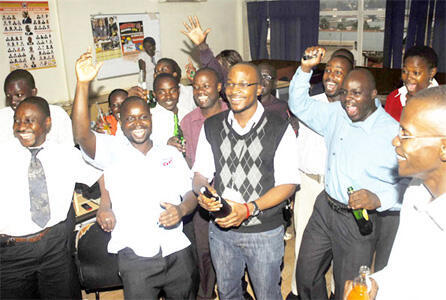 Journalists at Uganda's Daily Monitor newspaper celebrate the decision to get rid of the sedition law.
