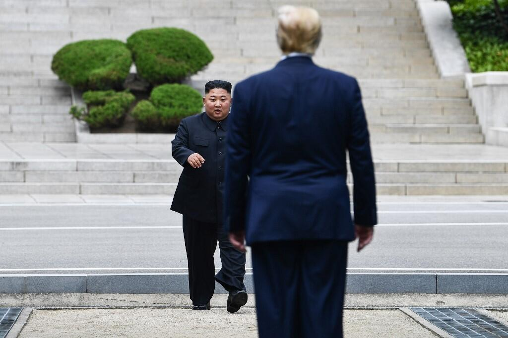 US president Donald Trump and North Korea's leader Kim Jung-un meet in the Demilitarized Zone (DMZ) in Panmunjom on 30 June, 2019.