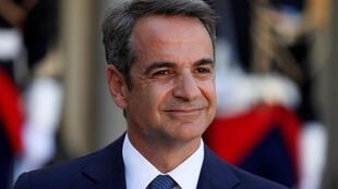 Greek Prime Minister Kyriakos Mitsotakis attends a joint statement with French President Emmanuel Macron (not seen) before a meeting at the Elysee Palace in Paris, France, August 22, 2019.