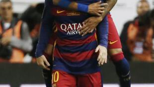 Goal scorer Neymar celebrates with Lionel Messi during Barcelona's Copa del Rey victory.