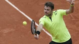 Switzerland's Stan Wawrinka playing Czech Republic's Lukas Rosol at Roland Garros on Monday