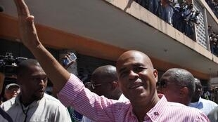 Martelly greeting supporters during the presidential vote on 20 March