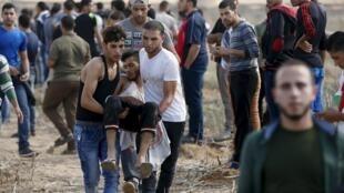 Một người Palestine bị thương do đạn Israel tại Gaza, 09/10/2015.
