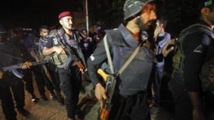 Quân đội và lực lượng an ninh lấy lại được kiểm soát khu sân bay quốc tế Karachi bị khủng bố tấn công ngày 08/06/2014.