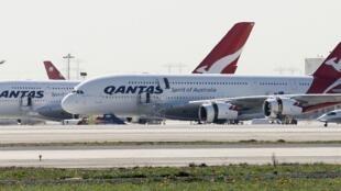 Qantas A380 jumbo jets sit idle at Los Angeles International Airport