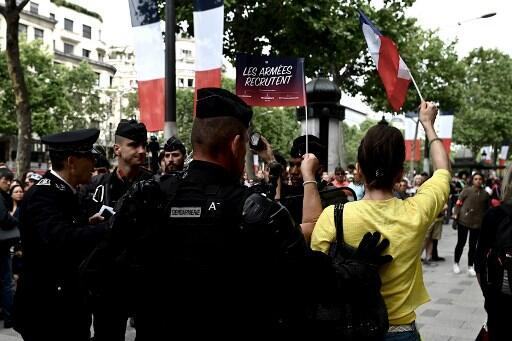 Protestors boo Emmanuel Macron as he goes down the Champs-Elysées for the Bastille Day parade
