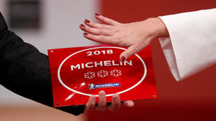 A plaque with the 2018 three Michelin stars is displayed during the Michelin Guide 2018 award ceremony at the Seine Musicale center in Boulogne-Billancourt near Paris, France, February 5, 2018.