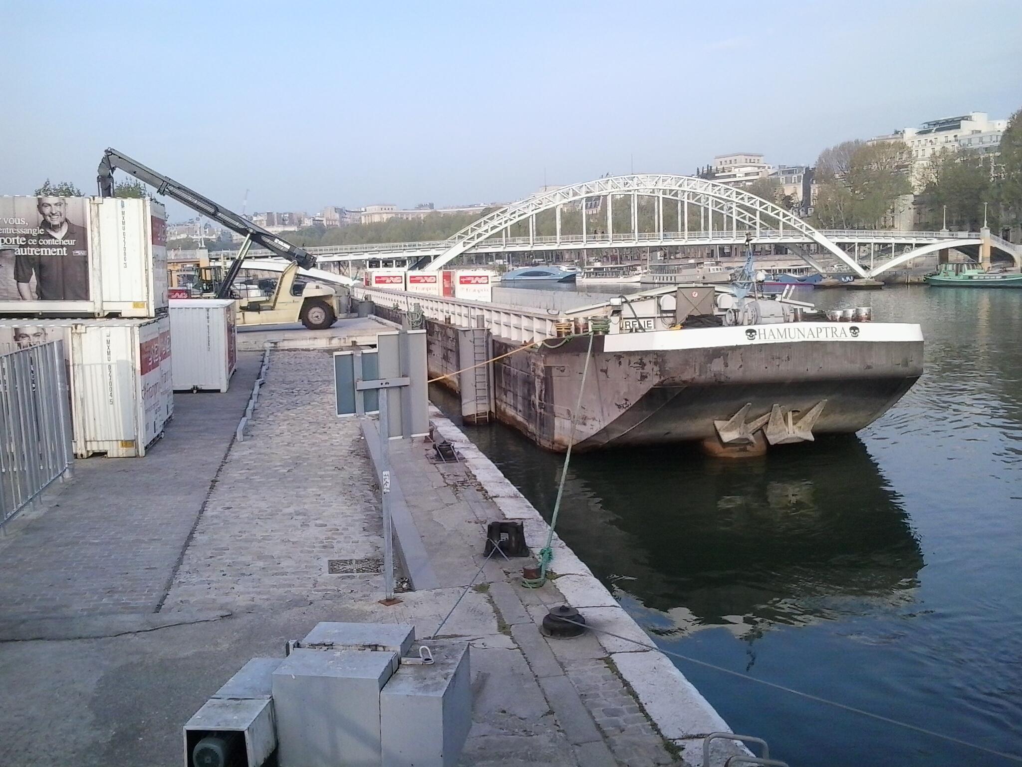 The barge carrying containers for Franprix at the Quai de la Bourdonnais, Paris.