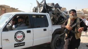 Mwanajihadi wa kundi la wapiganaji wa Dola la Kiislam katika mji wa Raqa nchini Syria, Septemba 16 mwaka 2014.