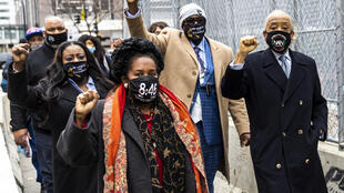 Members of George Floyd's family and Reverend Al Sharpton (R) were among many who gathered at the courthouse in Minneapolis, Minnesota for the trial of the white former police officer Derek Chauvin who was ultimately convicted of murdering Floyd