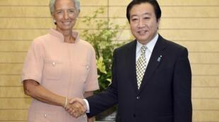 Christine Lagarde com o primeiro ministro japonês Yoshihiko Noda durante encontro em Toquio nesta sexta-feira (6).