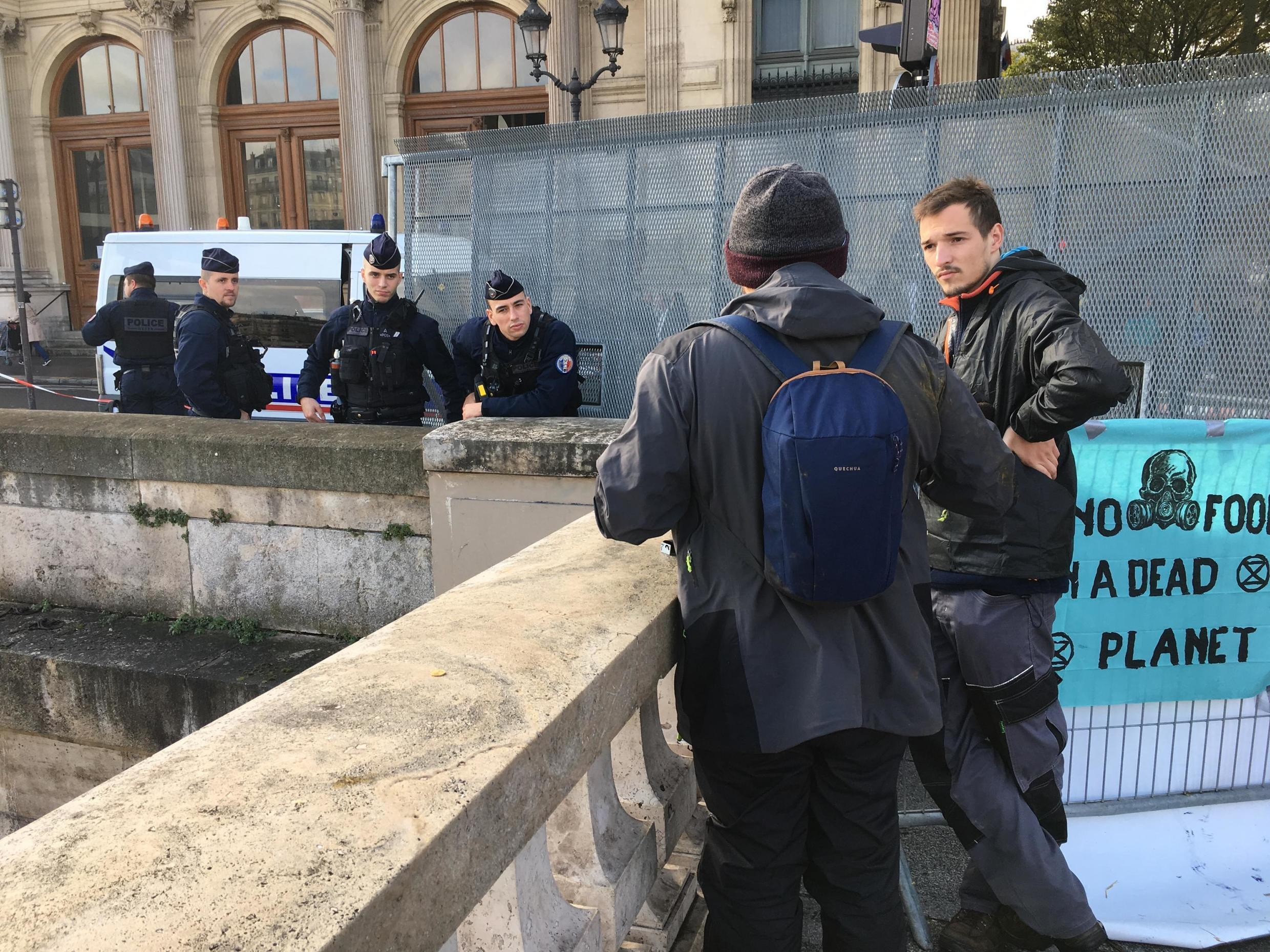 Activists at the unauthorized gathering chat with police officers. Some police vehicles were parked around nearby streets, and activists wondered how long it would be before they are ordered to evacuate the square.