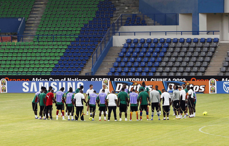 Ghana's team prays before a training session in Franceville