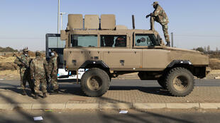 Reinforcements: Troops stand guard outside the Chris Hani shopping mall in Vosloorus on the outskirts of Johannesburg