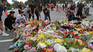 Flowers in tribute to victims, near Masjid Al Noor in Christchurch.