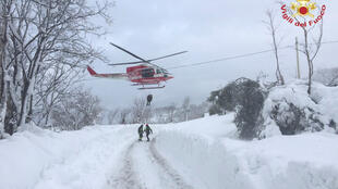 Rescue services arrive at the scene of an avalanche in central Italy on January 19, 2017.
