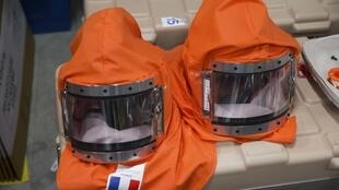 Masks used by volunteers to work in Ebola-hit areas at a training session in Paris