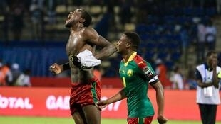 Michael Ngadeu-Ngadjui, who scored Cameroon's first goal celebrates his side's semi-final victory over Ghana with skipper Benjamin Moukandjo.