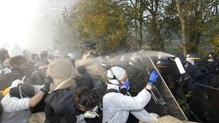 Protesters clash with CRS riot police on the track that the nuclear-waste train was due to take