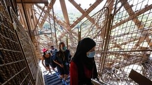 Visitors return to the Eiffel Tower on 25 June 2020 and tackle the 600-step climb