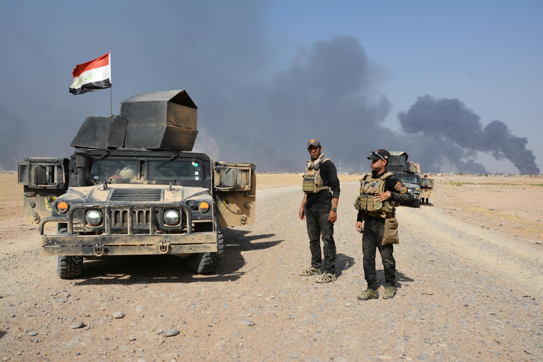 Vikosi vya usalama vya Iraq karibu na mji wa Qayyarah, Iraq, Agosti 15, 2016.