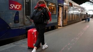 Travelers on the few trains running in France, as strikes continue through the holidays.