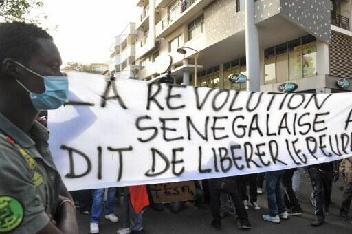 The Senegalese revolution says Free the people, reads an opposition banner