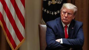 Donald Trump à la Maison Blanche, le 14 avril 2020. Ce jour-là, le président américain a pris la décision de ne plus contribuer au financement de l'OMS.