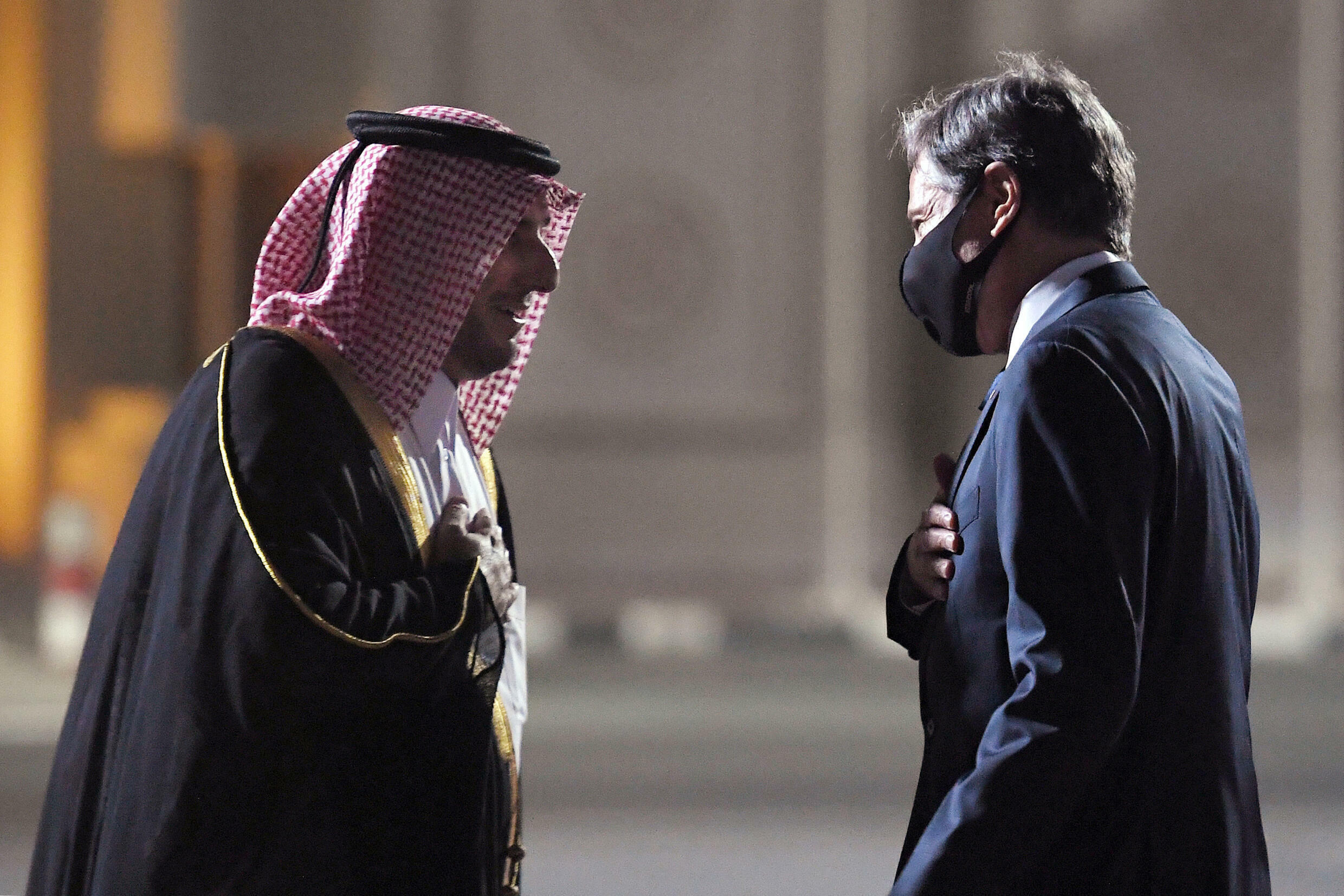 Secretary of State Antony Blinken (R), seen here being greeted by a Qatari diplomat upon his arrival in the Gulf state, is the most senior US official to visit the region since the Taliban's lightning takeover of Afghanistan on August 15