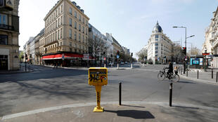 A lone cyclist rides in the Grands Boulevards commercial area of Paris during coronavirus lockdown in March. Like many European countries, France responded to the economic shock of the Covid-19 epidemic with a mix of state guarantees on loans, budget revisions and tax deferrals.