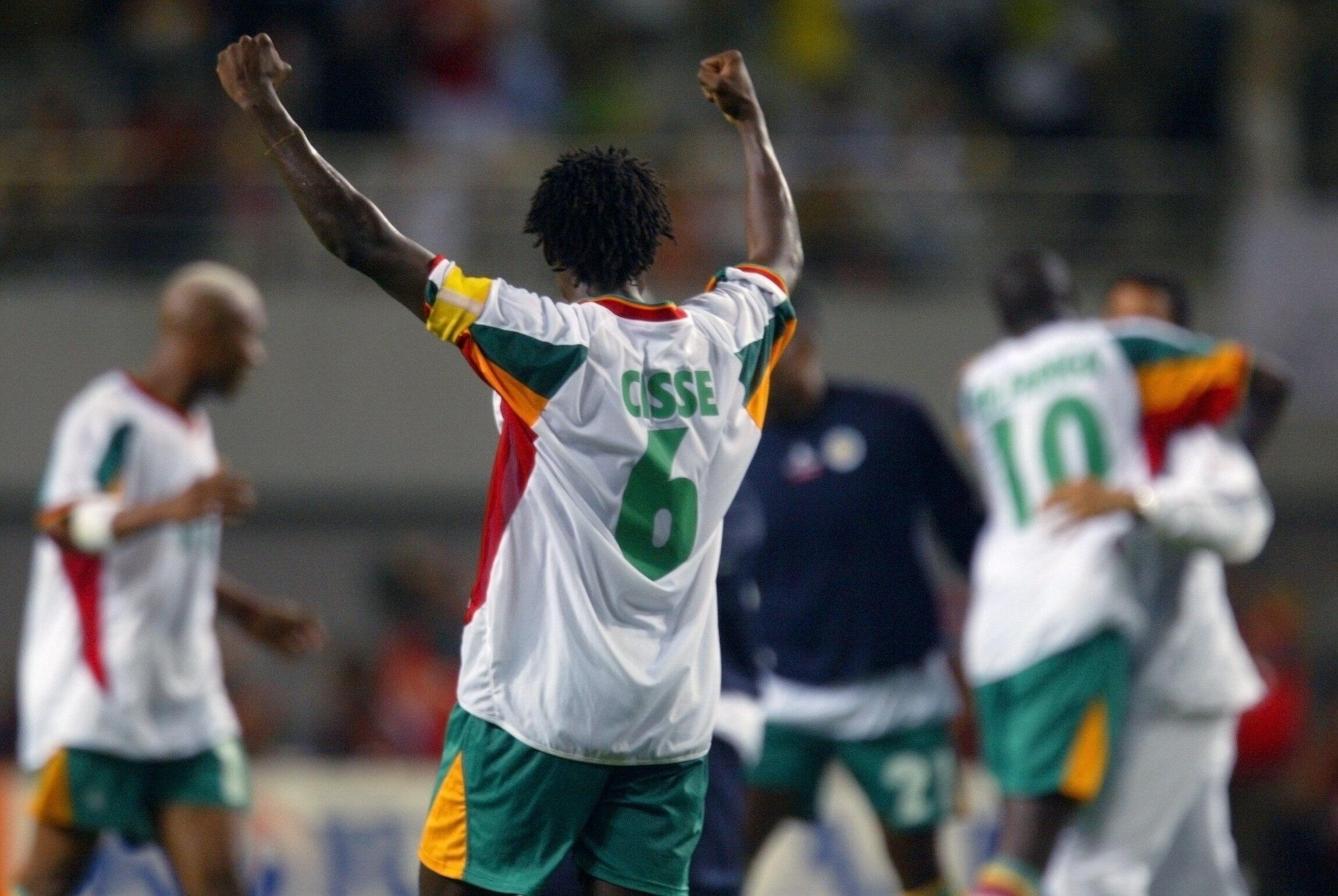Aliou Cissé capitaine des Lions lors de la victoire historique du Sénégal contre la France à la Coupe du monde 2002.