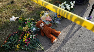 Passersby place flowers at the site of the Sutherland Spring church attack.
