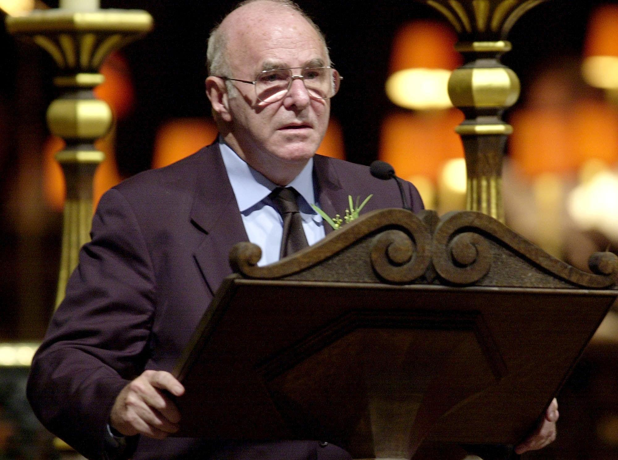 Australian TV host Clive James reads during a remembrance service for the Bali bombing victims at Saint Paul's Cathedral in central London 25 October 2002.